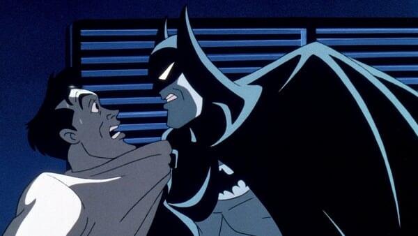 Batman amenazando a un sujeto